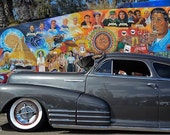 Fleetline in Aztlán Chevy Bomb parked at Chicano Park Mural