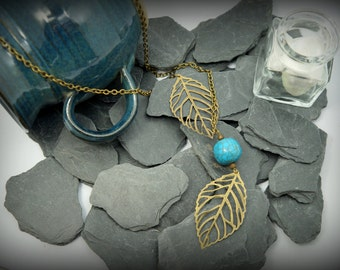 Leave: necklace lasso boho bronze color unbalanced, leaves and beads turquoise resin