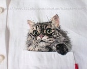 Hand embroidered cat in the pocket on the white linen shirt for women