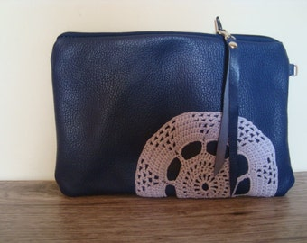 Natural leather clutch with vintage doily.