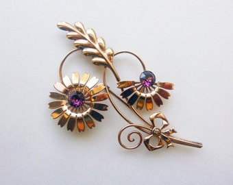 Art Deco to Retro yellow gold filled and purple rhinestone floral VanDell brooch