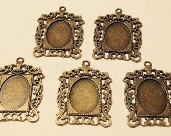 5 base for cameo rectangular in hypoallergenic bronze metal. 40 mm X 35 mm space inside oval.