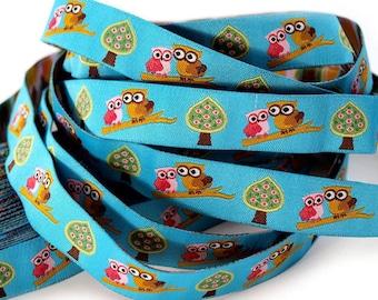 Web owls on branch - width 15 mm - blue