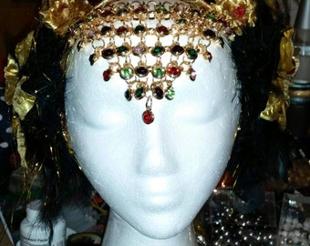 Gold feather headdress with beautiful tiered forehead piece