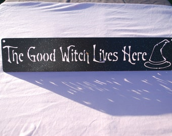 The Good Witch Lives Here Sign