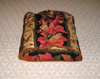 Dish carrier. Casserole dish carrier in a lush autumn floral print. Colorful fall leaves and berries. Velcro closures. 12x12 base.
