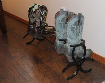 Horseshoe boot rack holds three pairs or six shoes.