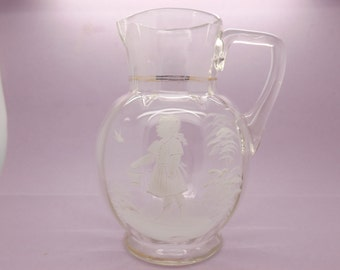 A very beautiful English Victorian period Mary Gregory style jug with children design in hand painted enamel on clear white blown glass