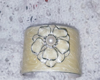 Ivory Tone Enamel Cuff Bracelet Featuring a Layered Petal Flower With Faux Pearl Center