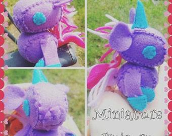 Miniature, enchanted, felt, plushie unicorn.