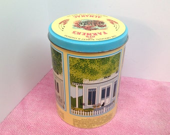 """OLD FARMER'S ALMANAC Tin is a Vintage 7 1/2"""" tall Tin Canister with Illustrations of the 4 Seasons on a Front Porch over Caption of Season"""