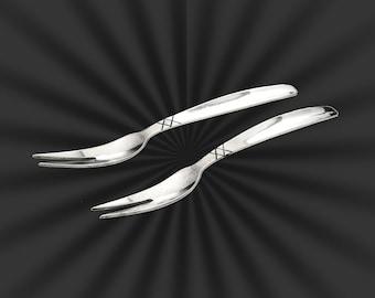 Allan Adler sterling 2 snail forks XX pattern
