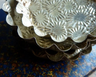 4 small vintage french tartlet tins with an embossed pattern