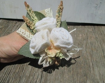 white burlap rose corsage with vintage ivory lace perfect for shabby country chic or boho wedding or baby shower