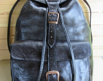 Handmade Guatemalan lamb leather black backpack. Large pocket, leather straps