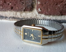 Genuine Vintage PULSAR ladies wrist watch - black square face two tone silver gold stretch band working condition watch