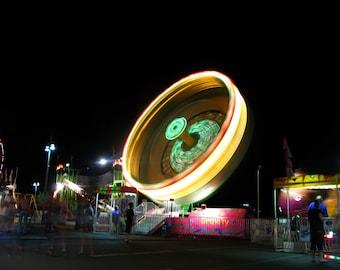 small spinwheel carnival ride at night