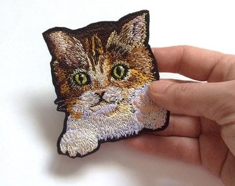 "Cat in Pocket Embroidery patch.  The approximate size 8 x 9cm (3.15 x 3.54"")"