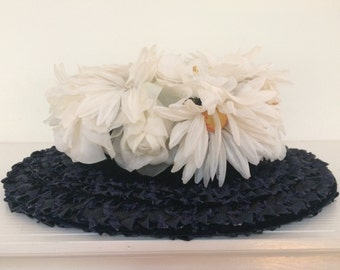 Navy Blue Woven Straw Brimmed Hat Topped With White Flowers - Roberta Bernays Brimmed Straw Hat