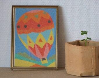 Sand painting from the 60's with metal frame - Colorful hot-air balloon -
