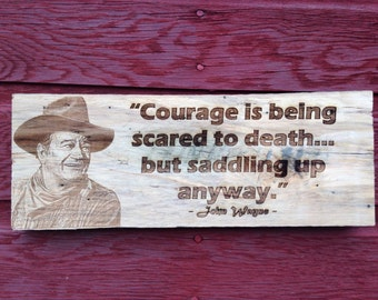 John Wayne quote on rough barnwood.