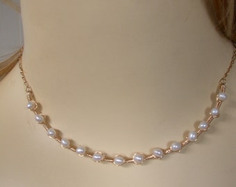white freshwater pearls wire wrapped with 14ct gold filled wire on a curved gold filled bar