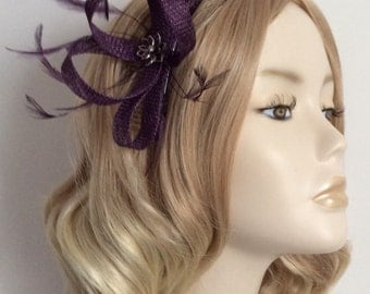 EMPEROR PURPLE FASCINATOR, Made of sinamay, with Rhinestone flower detail, Feathers,on a comb