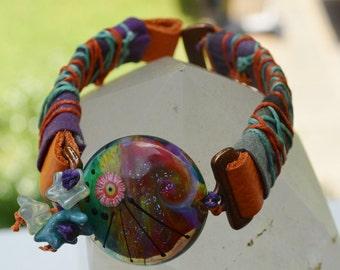 Batik wrapped leather lamp work bracelet Pegasus - DayLilyStudio