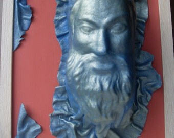 Bearded Man made from salvaged leather in a salvaged frame.
