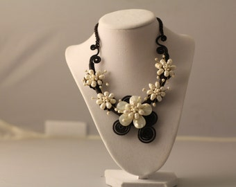 Paradise found enjoy this beautiful  hand made   mother of pearl and fresh water pearls adjustable necklace