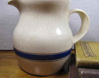 Lillian Vernon - Tan Pitcher - Blue and Brown Stripe