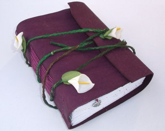 purple leather cover, with flower.