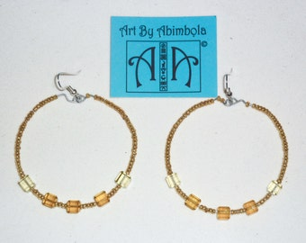 Hoop earrings with crystals and beads - yellow