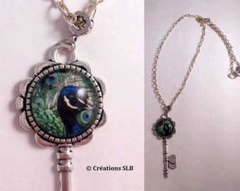 Long necklace with key and cabochon Peacock pendant