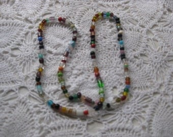 R- Glass Mardi Gras beads from New Orleans Carnival Parade