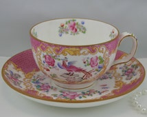 Antique, Oriental Garden Teacup & Saucer Bone English China made by Minton in 1912s in England.