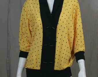 loud and yellow polka dot blouse