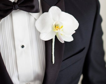 orchid boutonniere,wedding accessories,bride flowers