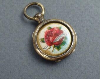 small Gold locket w/ rose c 1860