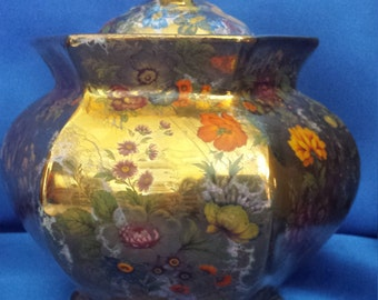 Sylia Smith cermic gold  pot with lid.