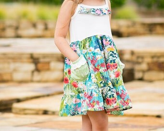 Missy's knit/ woven ruffle pocket dress. PDF sewing pattern for toddler girl sizes 2t - 12.