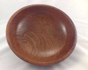 Mesquite wood bowl in a classic shape with band around the rim