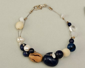 Tagua bracelet, navy beads bracelet, eco-chic jewelry, lapis bangle, women gift idea, exotic bangle, layered bracelet, organic jewelry.