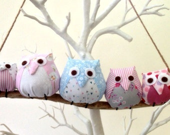 Owl family on a branch, 5 pastel owls