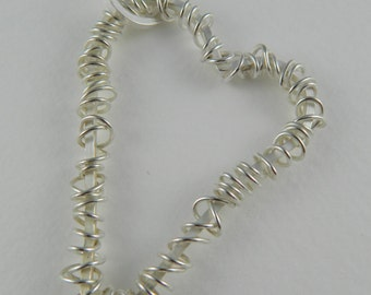 Silver twisted wire heart pendant
