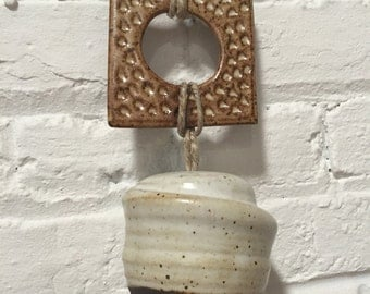 ceramic bell // wheelthrown & handbuilt // matte white on black stoneware