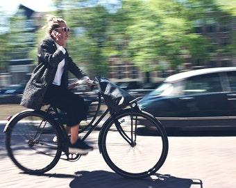 Amsterdam Biker on Cell Phone