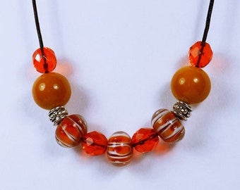Necklace orange beads fall in orange Pearl necklace on a black leather strap and pearls in autumn colors orange white jewellery