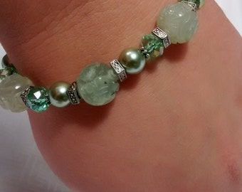 Carved green jade, crystal, and glass pearl bracelet