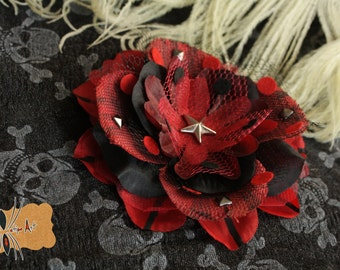 Flower red hair and black stripes and polka dots with stud. Day of the dead, pin-up, Gothic, Halloween.